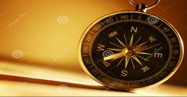 brass-magnetic-compass-conceptual-image-old-handheld-standing-upright-against-brown-background-copyspace-35897177